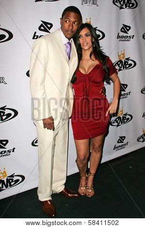 LOS ANGELES - OCTOBER 10: Nick Cannon and Kim Kardashian at the birthday party for Nick Cannon and the opening of his flagship store for PNB Nation on October 10, 2006 at PNB Nation Store, Los Angeles