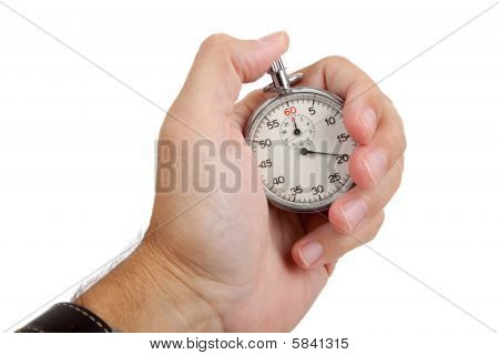 A Man's Hand Holding A Stop Watch