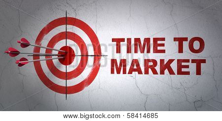 Time concept: target and Time to Market on wall background