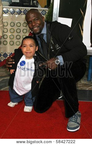 WESTWOOD, CA - DECEMBER 07: Joseph Calderon and Terry Crews at the premiere of