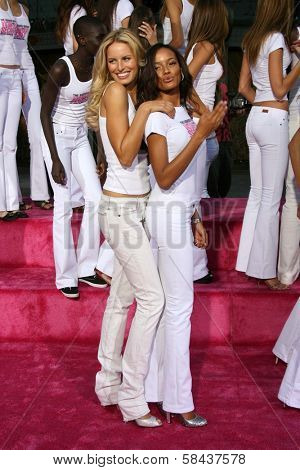 Karolina Kurkova and Selita Ebanks receiving the Key to the City of Hollywood. Grauman's Chinese Theatre, Hollywood, California. November 15, 2006.