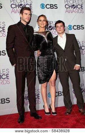 Liam Hemsworth, Jennifer Lawrence and Josh Hutcherson at the 2013 People's Choice Awards Press Room, Nokia Theatre, Los Angeles, CA 01-09-13