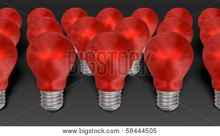 Group Of Red Reflective Light Bulbs On Grey Textured Background
