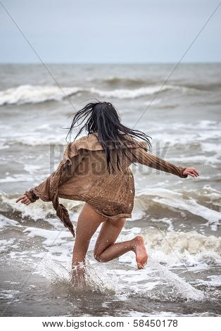 Seminude Woman In The Cold Sea Waves