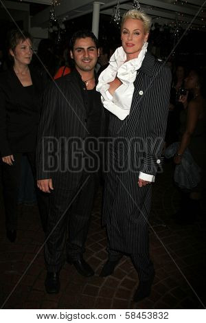 BEVERLY HILLS - DECEMBER 06: Brigitte Nielsen and husband Mattia at the Calabasas 2 Year Anniversary Party on December 6, 2006 at Fred Segal Mauro's Cafe in Beverly Hills, CA.