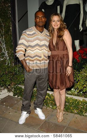 Alicia Silverstone and Kanye West at Stella McCartney Holiday Window Lighting to benefit the Kanye West Foundation Loop Dreams Program, Stella McCartney Boutique, Los Angeles, CA, December 5, 2006.