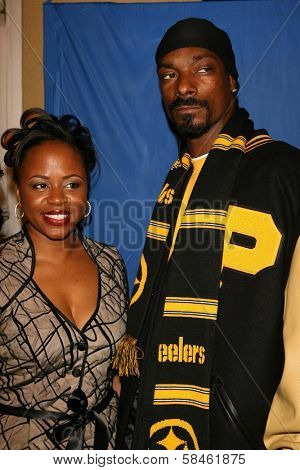 Snoop Dogg with a guest at the premiere of