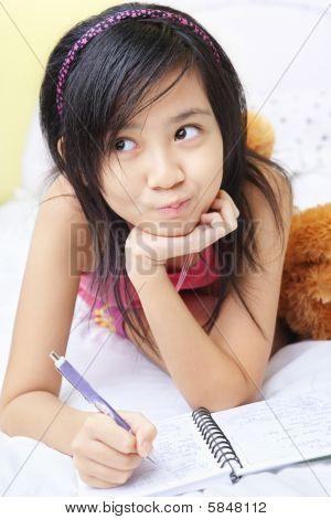 Little Girl Writing Her Diary