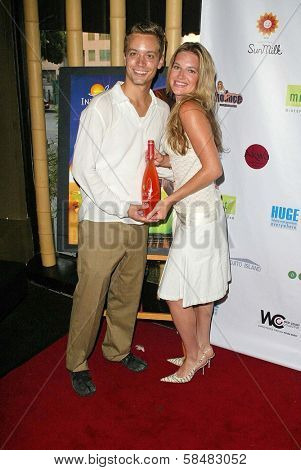 SANTA MONICA - JULY 23: Katie Whicker and Sean Davis at the Sexy Summer Soire Party hosted by H.U.G.E benefiting Heal The Bay at AKWA Restaurant and Club on July 23, 2006 in Santa Monica, CA.