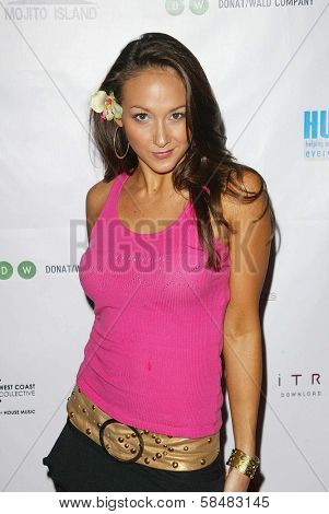 SANTA MONICA - JULY 23: Lauren Madden at the Sexy Summer Soire Party hosted by H.U.G.E benefiting Heal The Bay at AKWA Restaurant and Club on July 23, 2006 in Santa Monica, CA.