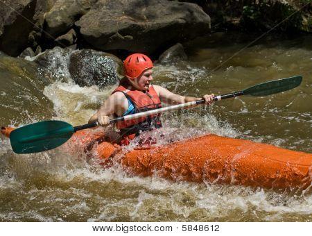 Teenage Girl White Water Kayaking
