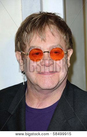 Elton John at Tom Ford Cocktails In Support Of Project Angel Food Media. Tom Ford, Beverly Hills, CA 02-21-13