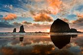 image of shoreline  - Haystack Rock at sunset Cannon Beach Oregon - JPG
