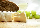 image of brie cheese  - Cheese with wine and bread. Food background.
