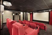 image of home theater  - Home theater in luxury home with red chairs - JPG