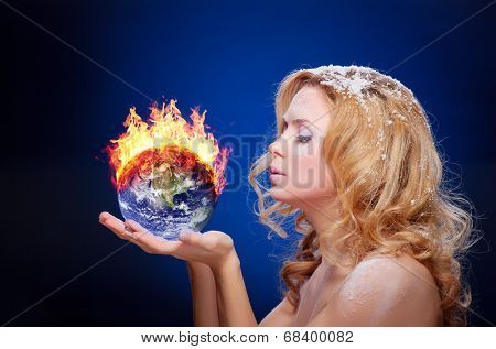 Frozen girl holding burning earth globe (west hemisphere) in palms (elements furnished by NASA) - version without glowing