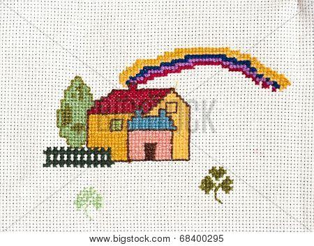 Cross-stitched house