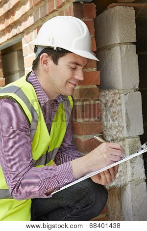 Architect Checking Insulation During Construction Project