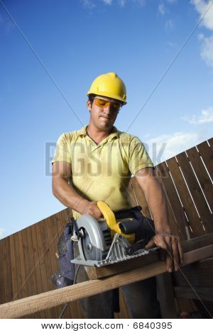 Construction Worker Cutting Wood