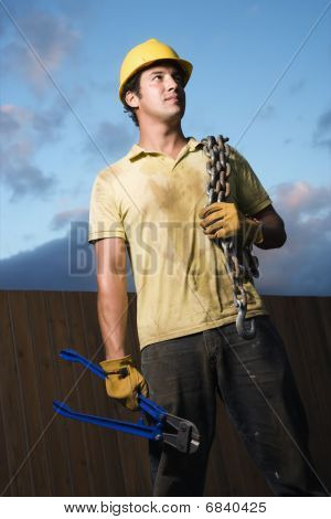 Construction Worker With Bolt Cutters And Chain