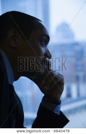 Pensive Businessman By Window