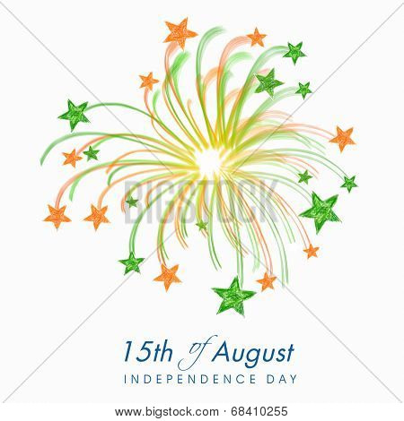 Beautiful fireworks in Indian trio colors with stars on grey background for 15th of August, Indian Independence Day celebrations.