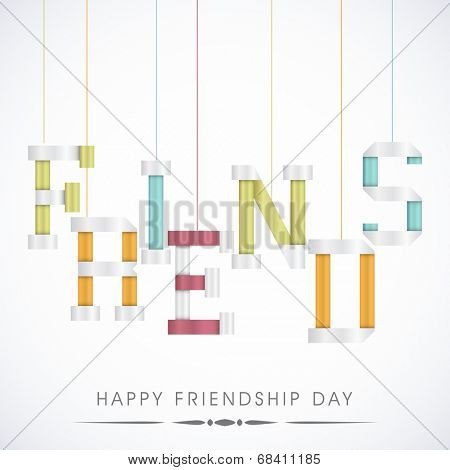 Hanging colorful text Friends on grey background for Happy Friendship Day celebrations concept.