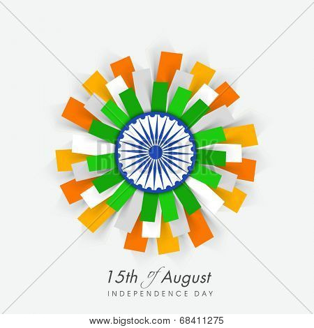 Beautiful flower design in Indian national flag colors with ashoka wheel on blue background  for 15th of August, Independence Day celebrations.