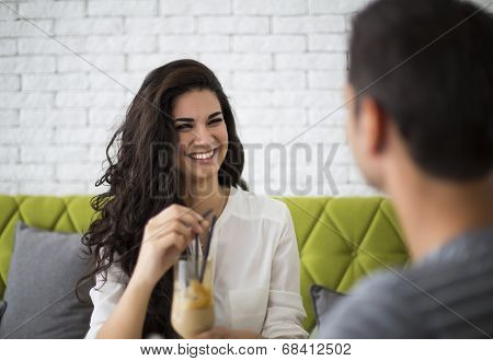 Young Couple In The Cafe