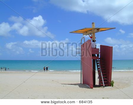 Lifeguard At His Post On The Beach