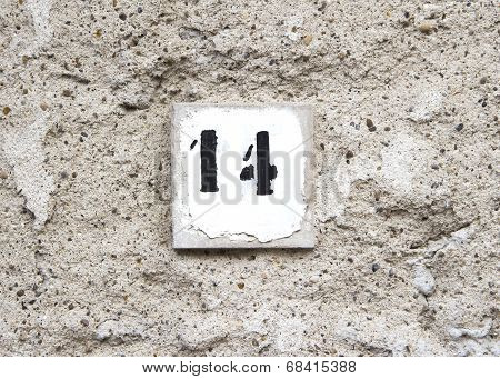 Number Fourteen On Old Wall