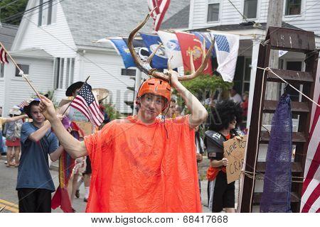 Man walking in the Wellfleet 4th of July Parade in Wellfleet, Massachusetts.