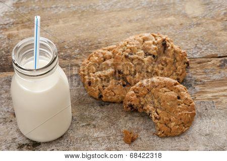 Bottle Of Milk With Half Eaten Cookies