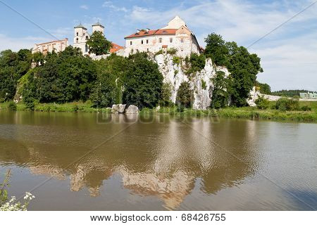 The Benedictine Abbey in Tyniec with wisla river on blue sky background