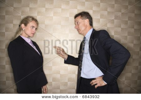 Businessman Reprimanding Businesswoman