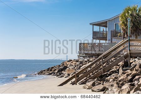Beach House With Bridge In Background