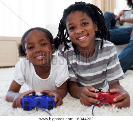 Close-up Of Siblings Playing Video Game