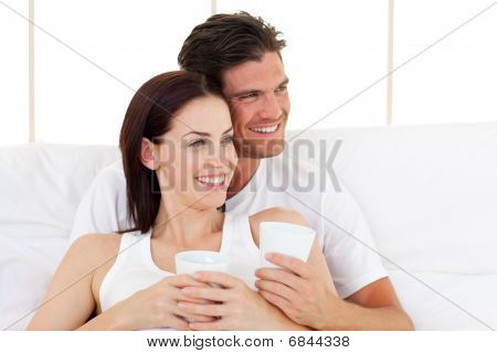 Smiling Couple Drinking Coffee