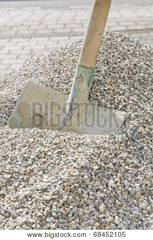 Used shovel in a heap of grit