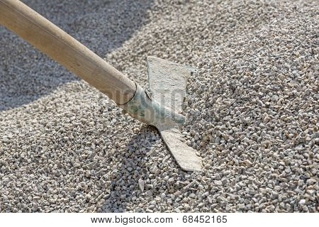 Shovel in a heap of grit