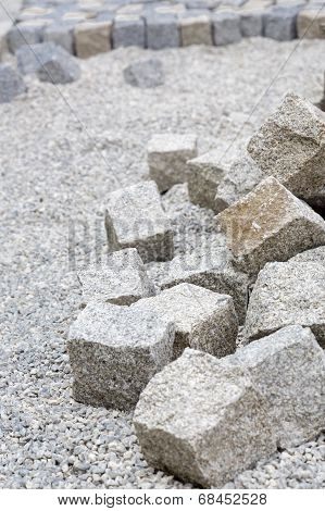 Paving works with new granite stones closeup