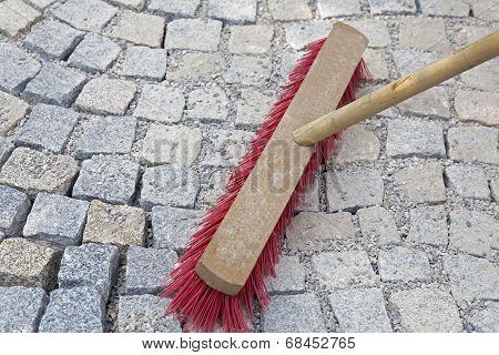 Brushing paving works with new granite stones