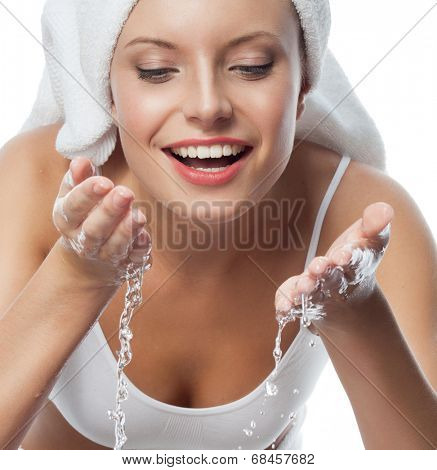 portrait of attractive  caucasian smiling woman isolated on white studio shot washing her face