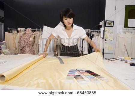 Fashion designer working at desk