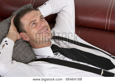 Businessman Laying On Couch