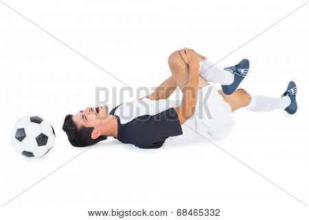 Football player in white lying injured on white background