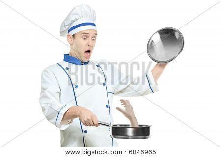 A supsised chef holding a frying pan