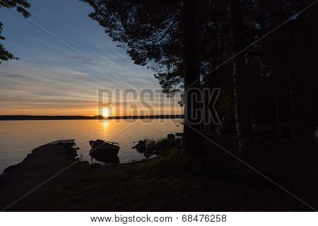 Sunset Over Lake With Dark Foreground