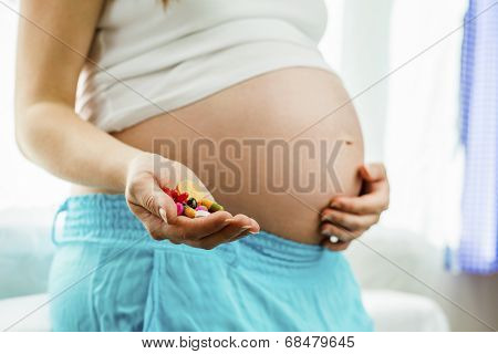 Pregnant woman with pills