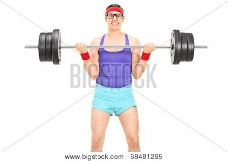 Nerdy guy lifting a heavy weight isolated on white background